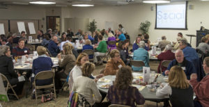 Nearly 100 people shared a light dinner together while the meeting continued.